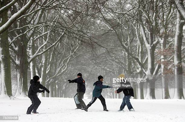 Children playing with snowballs in Abington Park as heavy snowfall sweeps across the country on February 8 in Northampton United Kingdom