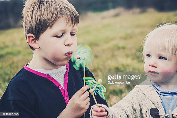 Children playing with toy windmills
