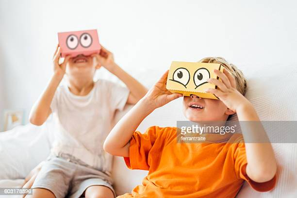children playing with virtual reality headsets - funny cartoon stock photos and pictures