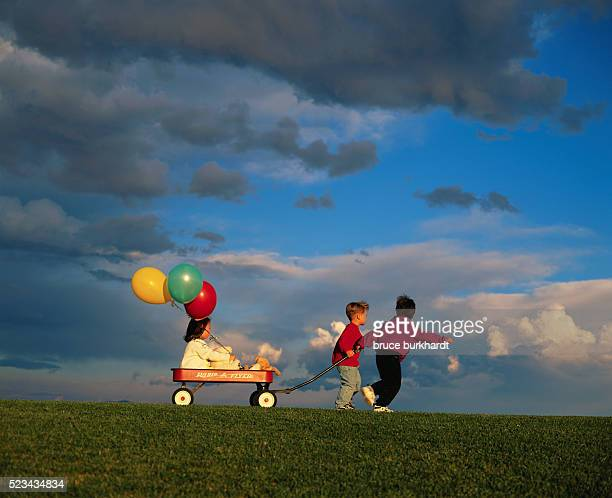 Children Playing with Wagon