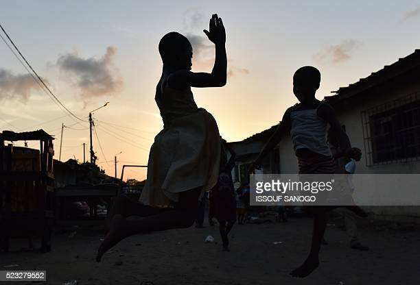 Children plays in the streets of the village of Anoumabo in Marcory district in Abidjan on April 22 during the Urban Music Festival of Anoumabo / AFP...