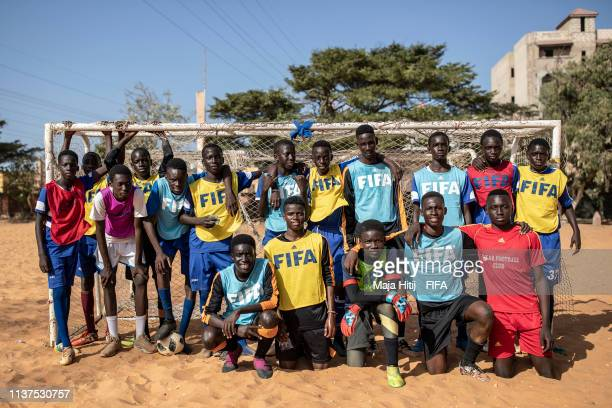 Children pose for a group picture during a FIFA Grassroots schools program on January 16 2019 in Dakar Senegal