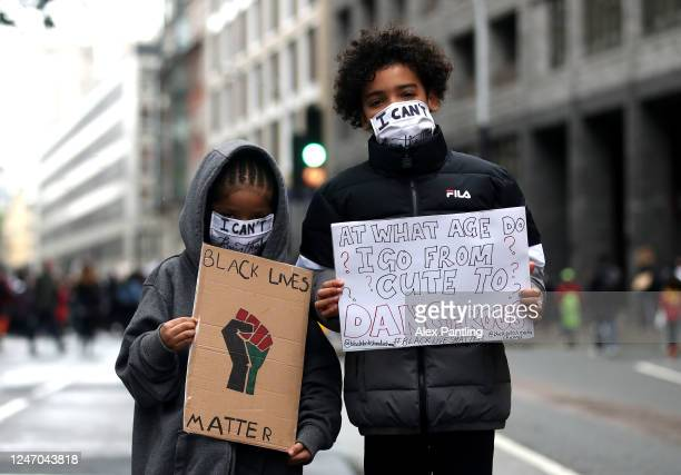 Children pose for a photo during a Black Lives Matter protest at Parliament Square on June 06, 2020 in London, United Kingdom. The death of an...