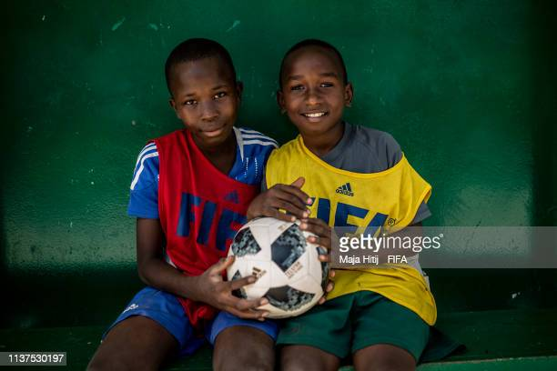 Children pose for a photo during a FIFA Grassroots schools program on January 17 2019 in Dakar Senegal