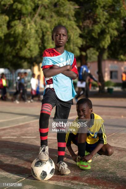 Children pose for a photo during a FIFA Grassroots schools program on January 18 2019 in Dakar Senegal