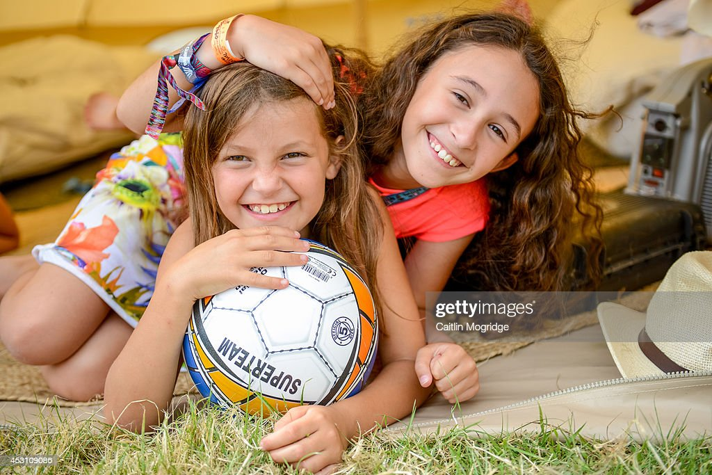 Children pose for a photo on the first day of Camp Bestival at Lulworth Castle on July 31, 2014 in Wareham, United Kingdom.