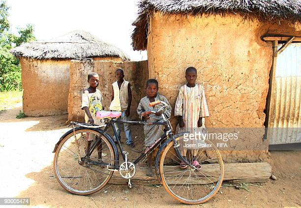 Children pose for the camera next to a bike on November 07 2009 in Bauchi Nigeria