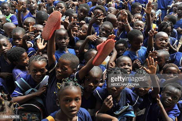 Children pose for the photographer as they leave school on February 7, 2012 in Bata, one of the four cities hosting matches of the 2012 Africa Cup of...