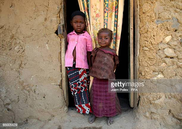 Children pose in the door frame of their mud and brick home on November 07 2009 in Bauchi Nigeria
