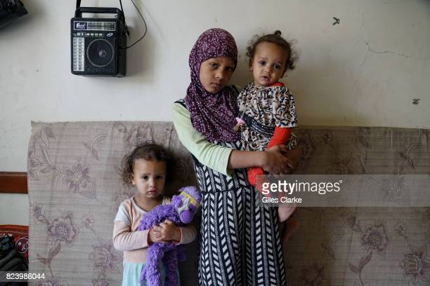 A YEMEN 1 MAY Children pose inside their room in a building situated on the outskirts of Sana'a The building is home to 23 families who fled to...