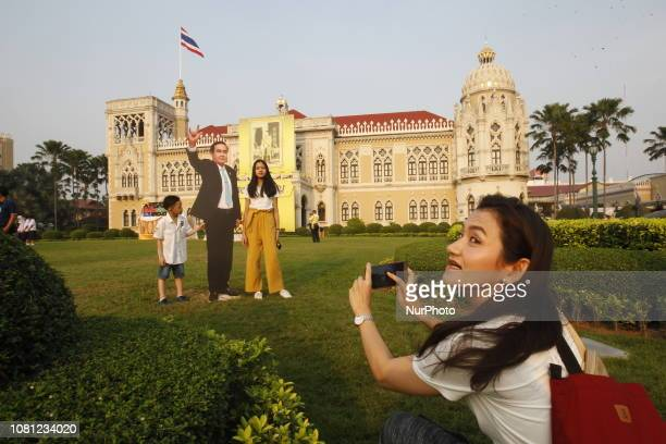 Children pose with a cardboard cutout of Thailand's Prime Minister Prayuth Chanocha during the Children's Day celebration at Government House in...
