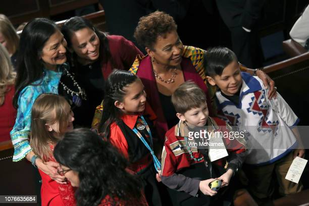 Children pose with memberelect Rep Deb Haaland Rep Sharice Davids Rep Barbara Lee during the first session of the 116th Congress at the US Capitol...