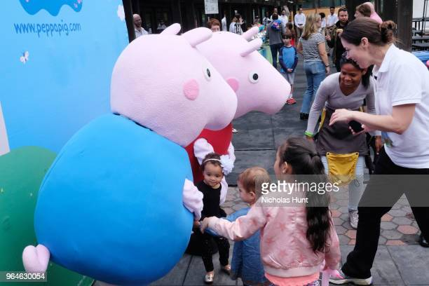 Children pose with Peppa Pig during GOOD Foundation's 2018 NY Bash sponsored by Hearst on May 31 2018 in New York City