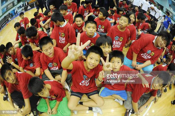Children poses following a clinic with the Indiana Pacers during an NBA Cares event on October 7 2009 at Taipei Gymnasium in Taipei Taiwan NOTE TO...