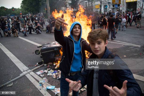 Children posse to the picture during riots in St Pauli district during G 20 summit in Hamburg on July 8 2017 Authorities are braced for largescale...