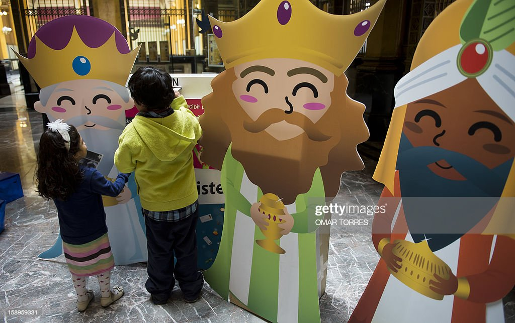 Children post letters to the Three Kings at the main post office in Mexico City on January 4, 2013. In Spanish-speaking parts of the world, children believe that the Three Kings receive their letters and so bring them gifts on the night before Epiphany. The Mexican Post Office opened this service to encourage the use of traditional mail.