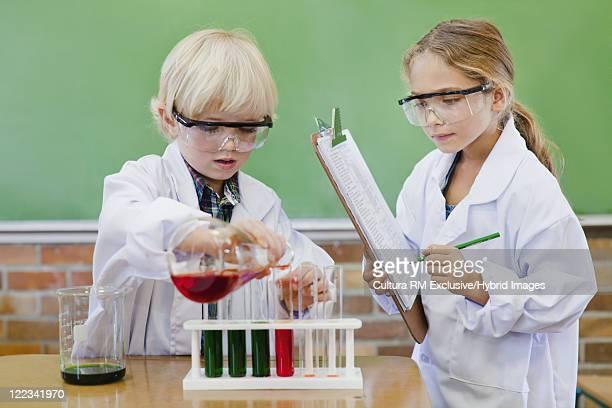 Children pouring liquid into test tubes