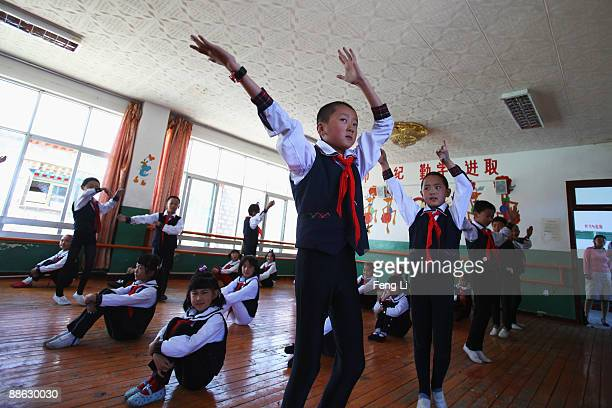 Children practice dance during a dance class at the Lhasa Experimental Primary School on June 19, 2009 in Lhasa, Tibet Autonomous Region, China....