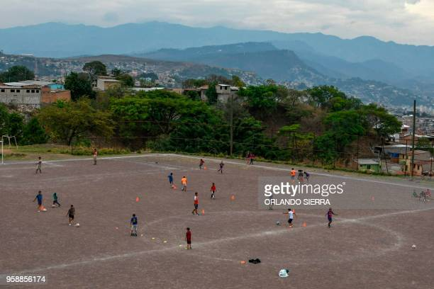 Children practice football on a field in the poor neighbourhood of Nueva Capital on the outskirts of Tegucigalpa on May 13 2018 Missionaries from the...