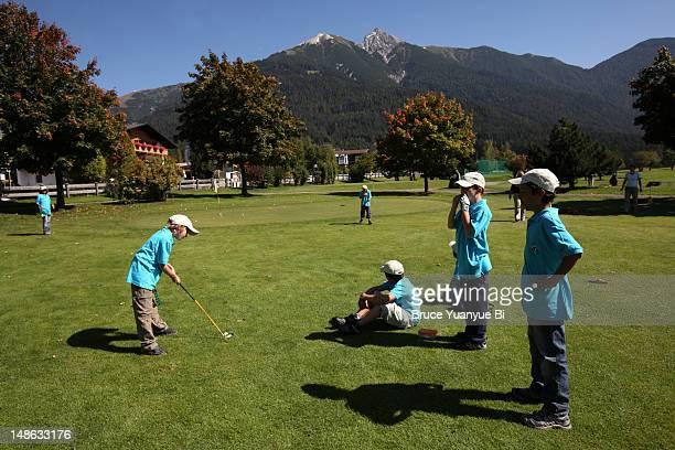Children practice golf in Golf Academy.