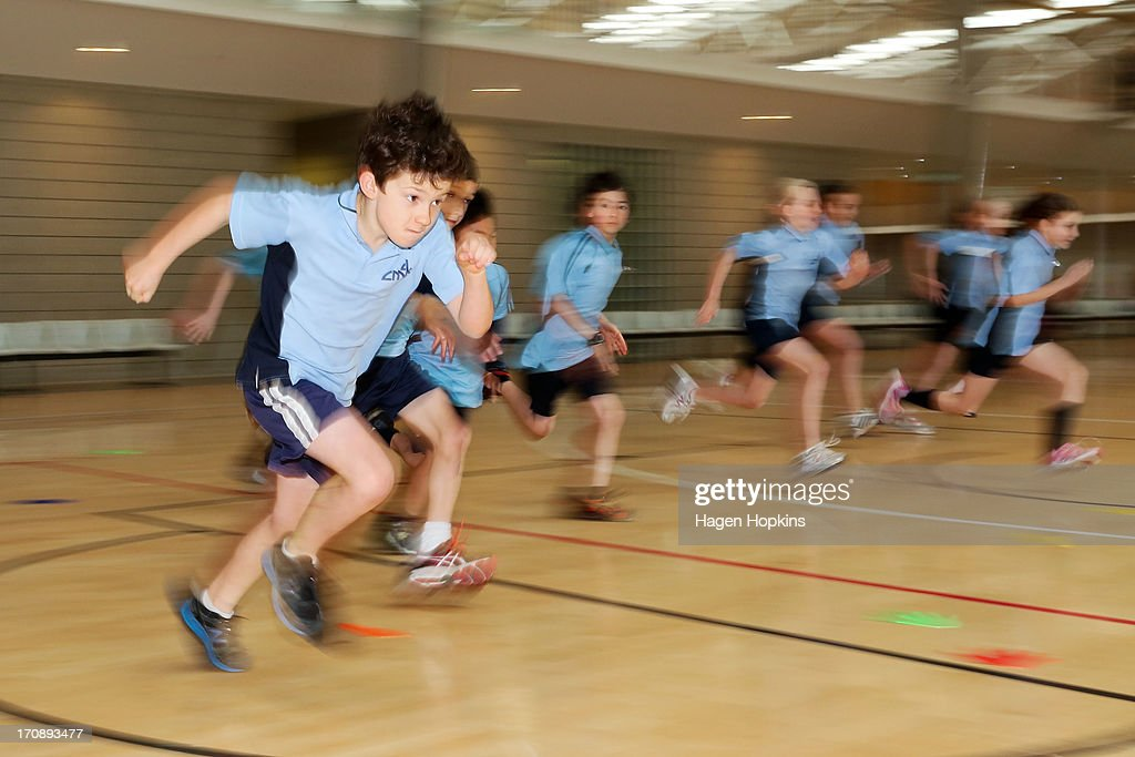 Children practice sprinting during the launch of the New Zealand Olympic Ambassador Programme at ASB Sports Centre on June 20, 2013 in Wellington, New Zealand.