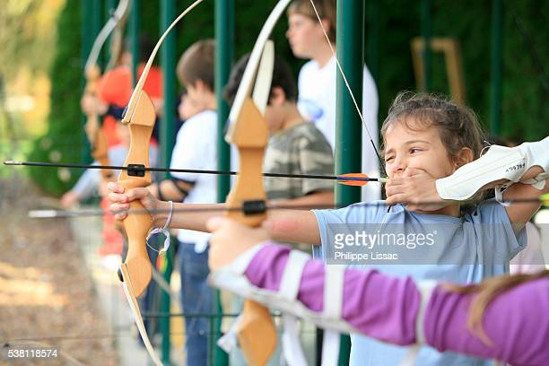 children practicing archery - archery stock pictures, royalty-free photos & images