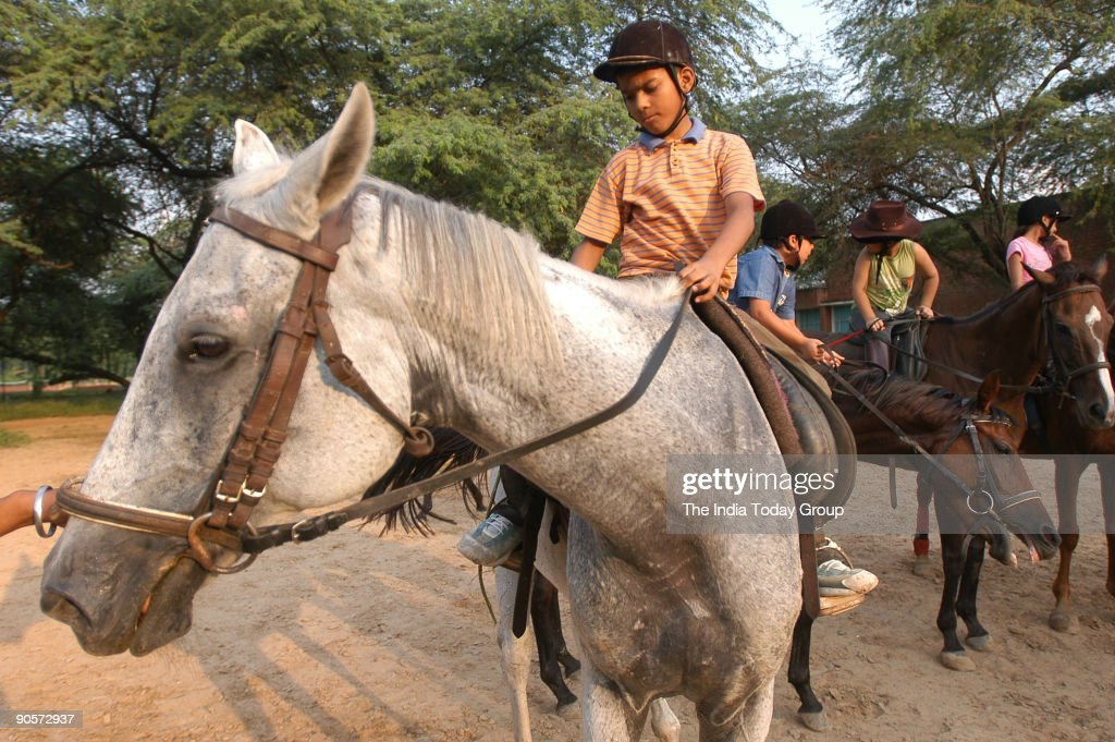 Children practicing Horse riding at the Chandigarh horse riding club in Chandigarh India