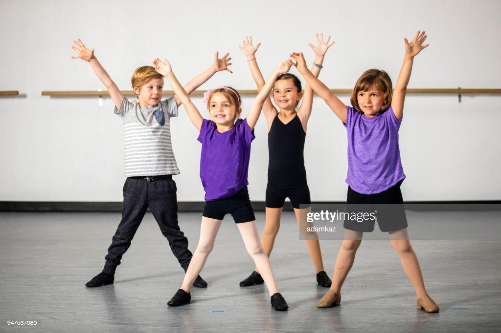 Children practicing musical theater in studio : Stock Photo