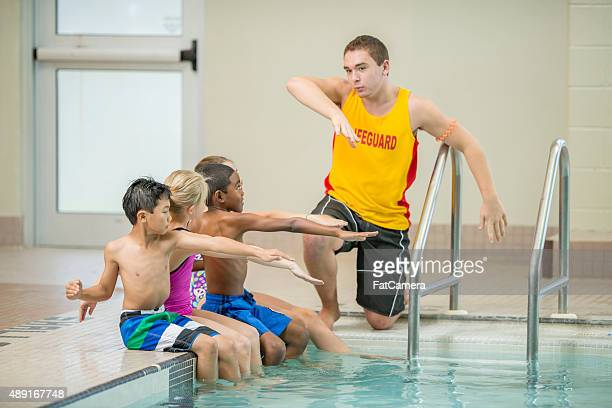 Children Practicing Swim Strokes