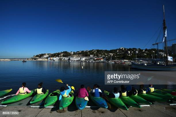Children practise kayaking on the Roucas nautical base on September 21 2017 in the southern Mediterranean city of Marseille which will host the...