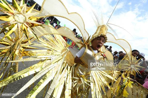 Children prance and masquerade in the Republic Bank Junior Carnival parade toward the main judging stage in the Queen's Park Savannah during Trinidad...