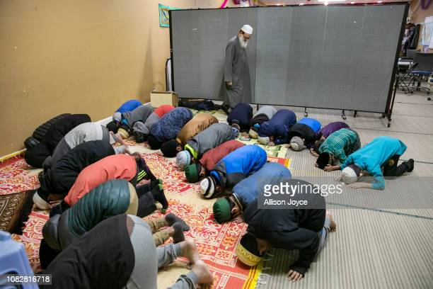 Children pray at the Rohingya Cultural Center of Chicago on January 11 2019 in Chicago Illinois Chicago has one of the largest number of Rohingya...