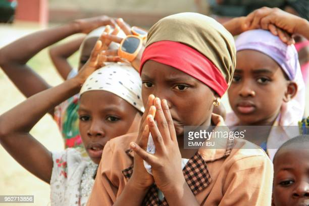 Children pray during as Christian community members take part in a protest against the killing of people by suspected herdsmen in Makurdi...