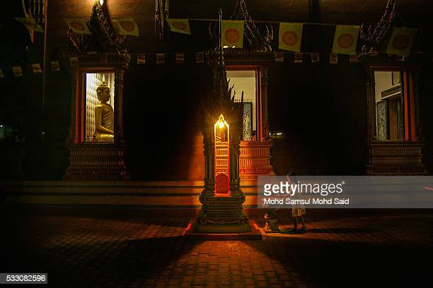 A children pray inside the temple on the eve of Vesak celebrations outside Kuala Lumpur on May 20 2016 in Ipoh Malaysia Buddhists across the world on...
