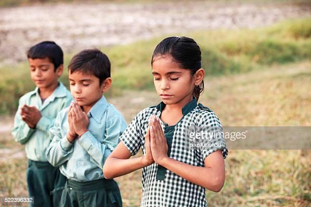Children praying in the Nature