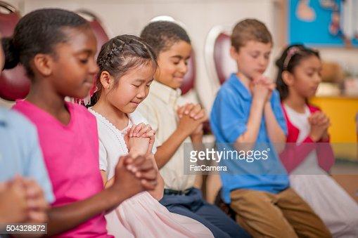 Children Praying Toget...