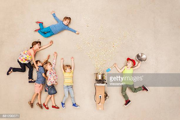 children preparing popcorn - human limb stock pictures, royalty-free photos & images