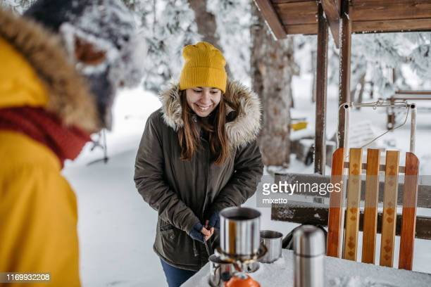 children preparing tea in winter outdoors - 12 17 months stock pictures, royalty-free photos & images