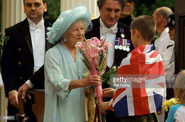 Children present Britain's Queen Mother with flowers during celebrations to mark her 101st birthday August 4 2001 in London The Queen Mother died in...