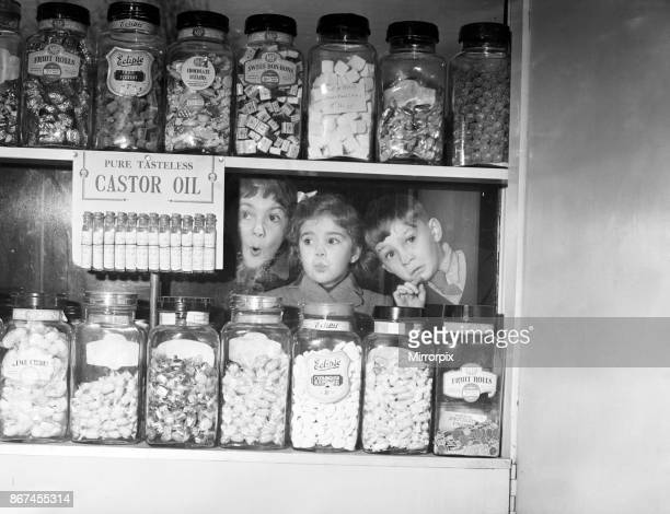 Children pressing their noses against the window of 'Mary's' sweet shop, Anniesland, Glasgow. Left to right, Michael Martin , Georgia Allison and...