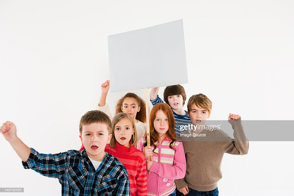 Children protesting with placard : Stock Photo
