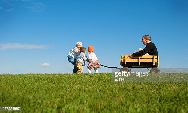 Children pulling Daddy in Wagon
