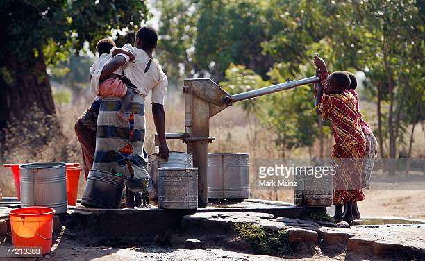 Children pump water outside of the Ligwangwa village October 3 2007 in Ligwangwa Malawi In an effort to spread hope education love and protection to...