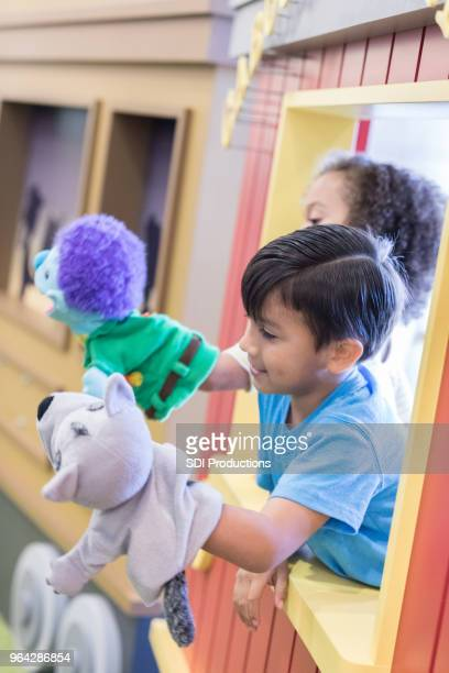children putting on puppet show - acting performance stock pictures, royalty-free photos & images