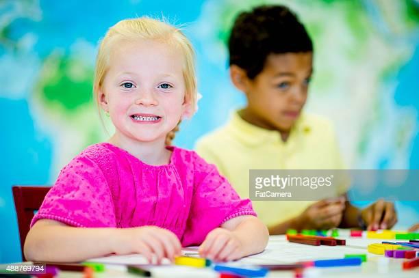 Children Putting Together Blocks