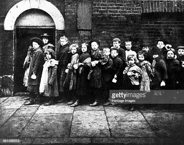 Children queuing for farthing breakfast Hanbury Street London