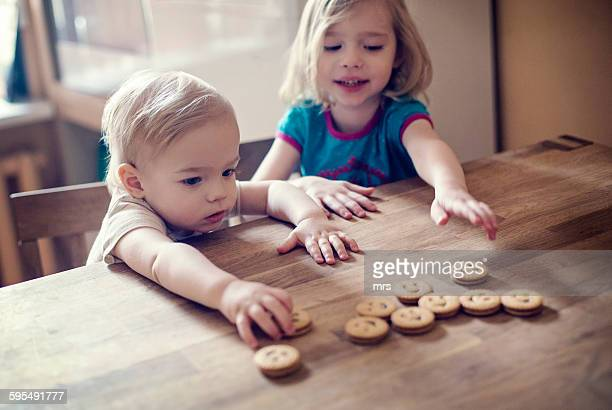 Children reaching for cookies