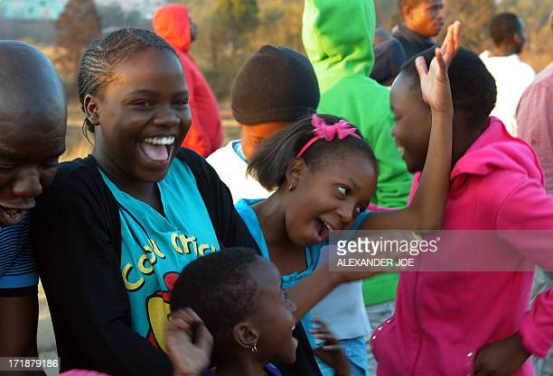"Children react after having seen Obama's car leaving Soweto on June 29, 2013. US President Barack Obama met the family of his ""inspiration"" Nelson..."
