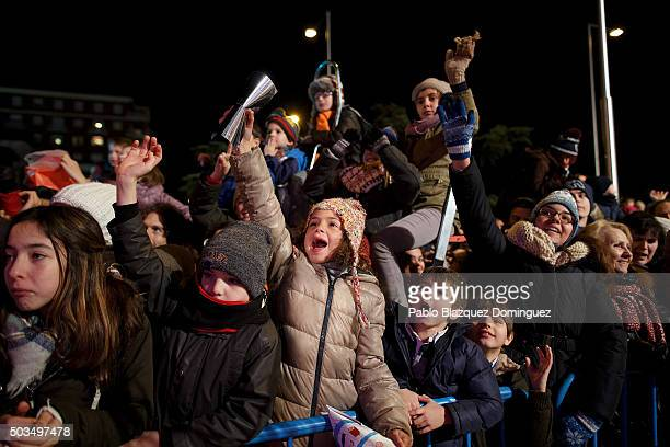 Children react as they see performers during the 'Cabalgata de Reyes' or the Three Kings parade on January 5 2016 in Madrid Spain The traditional...
