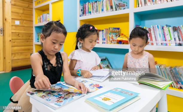 """Children read in the """"Hongyan study"""" in the square. Hohhot, Inner Mongolia, China, on the evening of July 23, 2020.- PHOTOGRAPH BY Costfoto /..."""